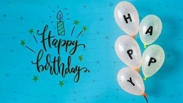 Felice scritto su palloncini per il giorno dell'anniversario Psd Gratuite