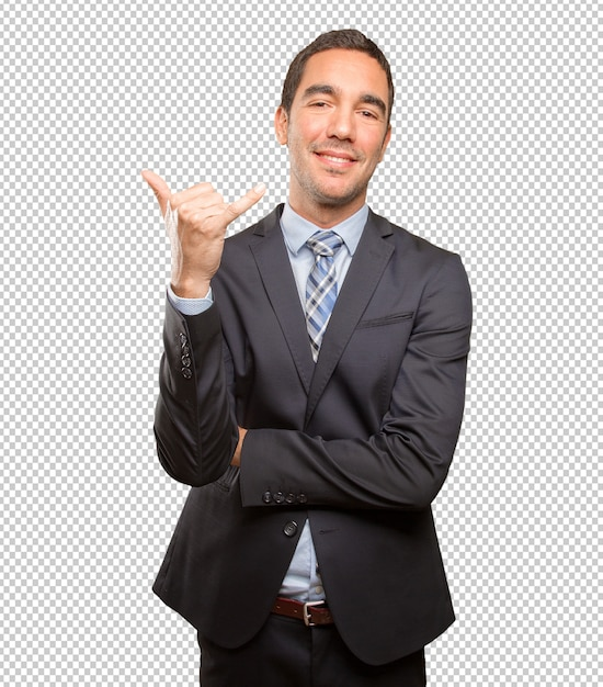 Fiducioso giovane imprenditore facendo un gesto di chiamata Psd Premium