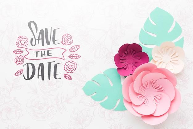 Flores de papel con maqueta de fondo de boda PSD gratuito