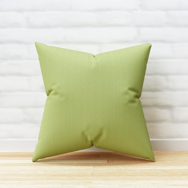 Forma verde del quadrato e del cuscino sul pavimento di legno e sul fondo bianco del muro di mattoni con il modello in bianco. mockup di cuscini per il design. rendering 3d. Psd Premium