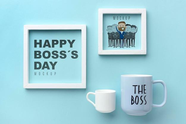 Gelukkige baas dag met frames en mokken Gratis Psd