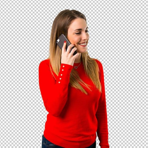 Gelukkige jonge blonde vrouw die aan mobiel spreekt Premium Psd