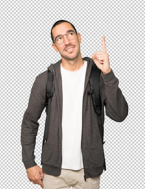 Gelukkige student die met zijn vinger benadrukt Premium Psd
