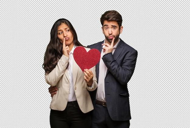 Giovane coppia a san valentino dubitando e confuso Psd Premium