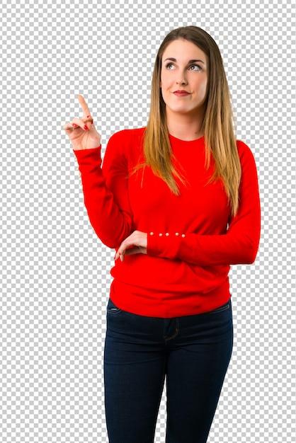 Giovane donna bionda che punta con il dito indice una grande idea Psd Premium