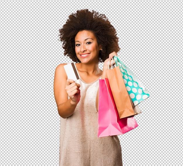 Giovane donna di colore che va a fare spese Psd Premium