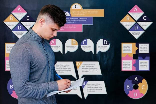 Giovane studente maschio alla scrittura universitaria Psd Gratuite
