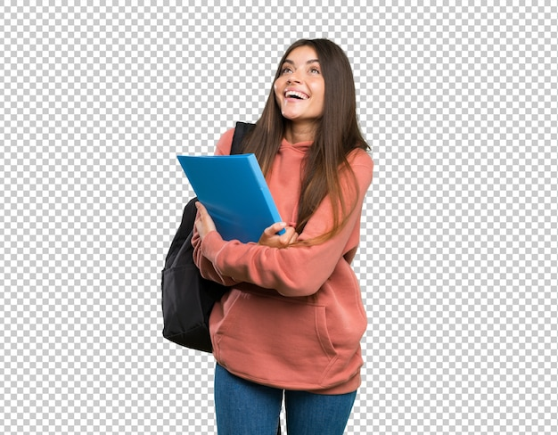 Giovani taccuini della tenuta della donna dello studente che guardano su mentre sorridendo Psd Premium