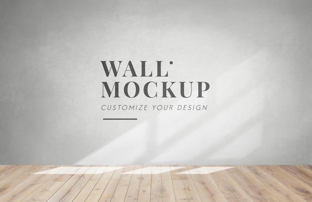 Habitación vacía con una maqueta de pared gris PSD gratuito