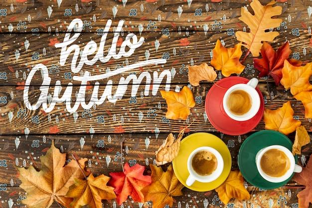 Hallo herfst concept met kopjes koffie Gratis Psd
