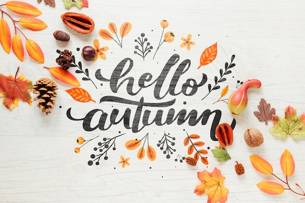 Hallo herfst kalligrafie met bladeren Gratis Psd