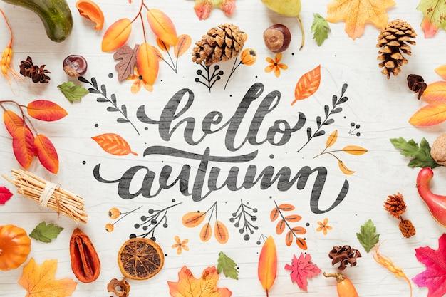 Hallo herfst kalligrafie omringd door herfst decor Gratis Psd