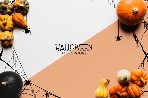 Halloween-conceptenachtergrond met pompoenen Gratis Psd