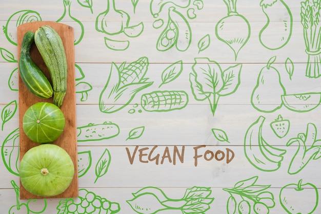 Hand getekend veganistisch eten achtergrond Gratis Psd
