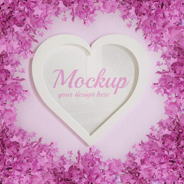 Hartvorm frame mockup omlijst door roze bladplanten Premium Psd