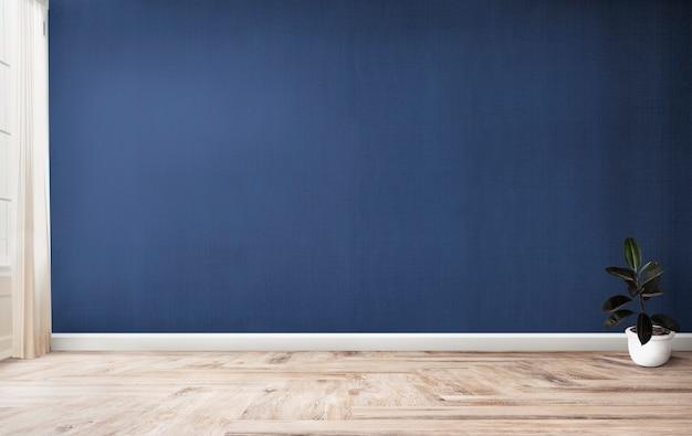 Higo de goma en una habitación azul. PSD gratuito