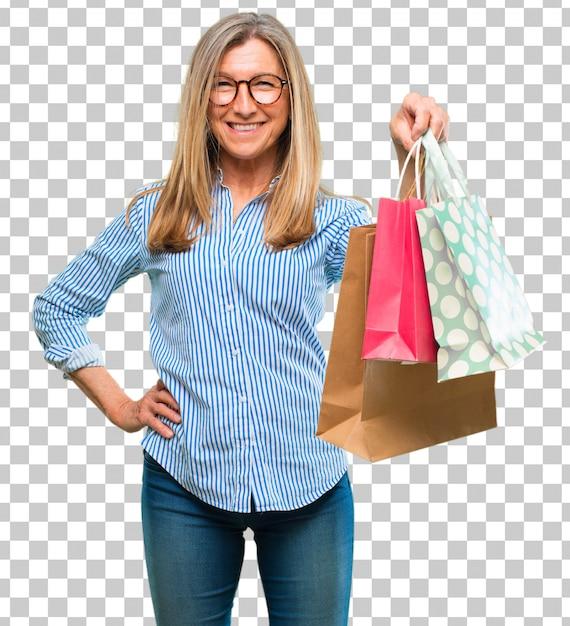 Hogere mooie vrouw met het winkelen zakken Premium Psd