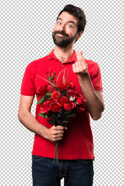 8a65f5242559f Hombre guapo sosteniendo flores haciendo gesto de dinero