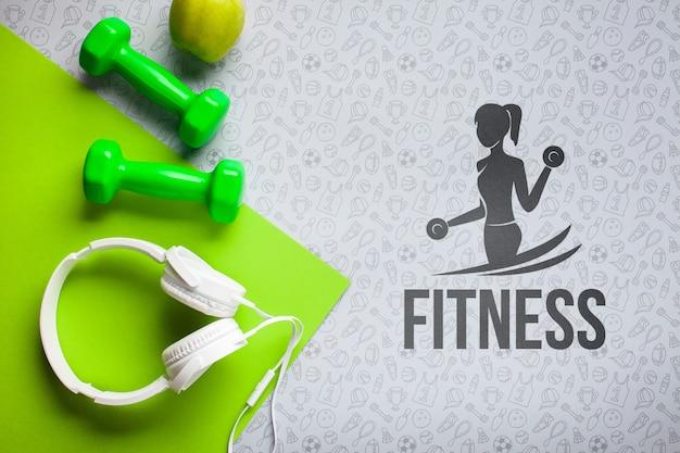 Hoofdtelefoons en gewichten voor fitnessles Gratis Psd