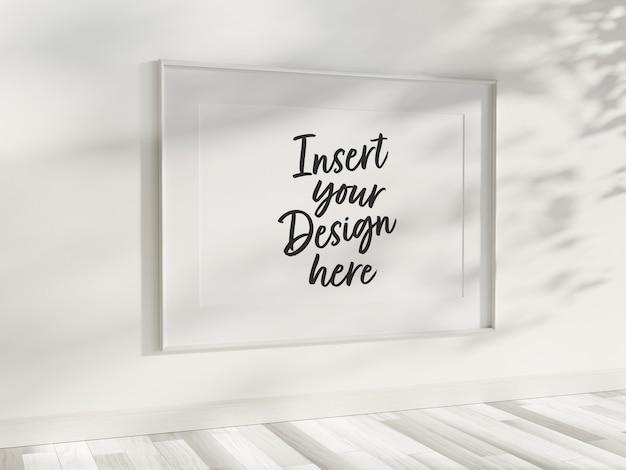 Horizontaal frame dat op muurmodel hangt Premium Psd