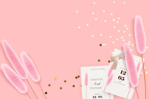 Huwelijksuitnodiging op roze achtergrond Premium Psd