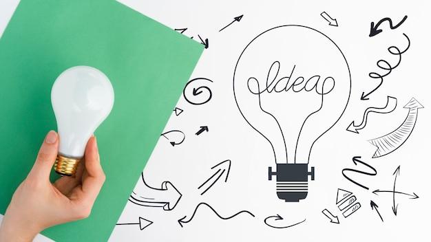 Idea di concetto di doodle con schizzi di lampadina Psd Gratuite