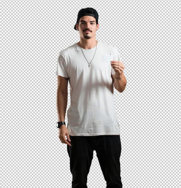 Il giovane rapper sorride fiducioso, offre un biglietto da visita, ha un'attività fiorente Psd Premium