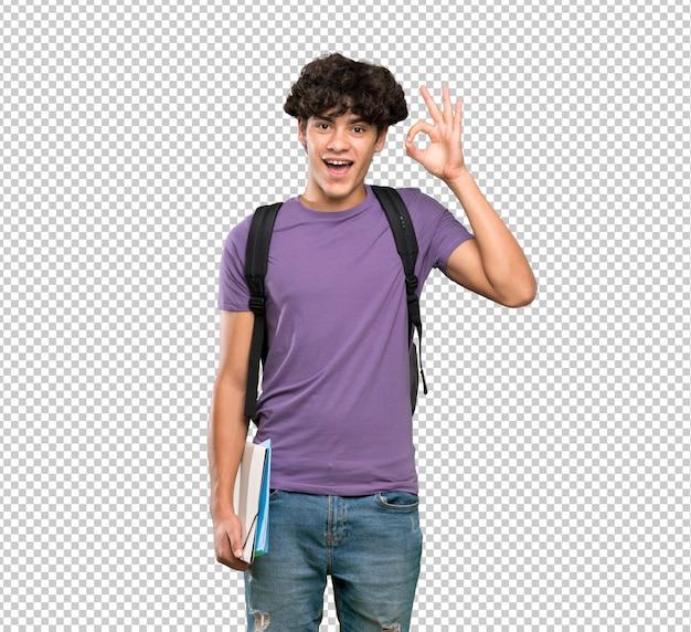 Il giovane uomo dello studente ha sorpreso e mostrando il segno giusto Psd Premium