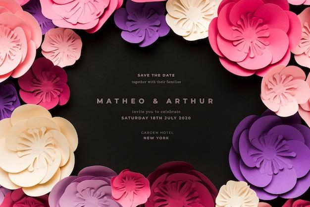 Invitación de boda negra con flores de papel PSD gratuito