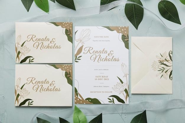 Invitación de boda plana con hojas PSD gratuito