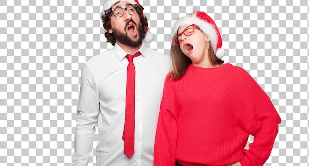 Jong paar die kerstmisconcept uitdrukken. paar en achtergrond in verschillende lagen Premium Psd