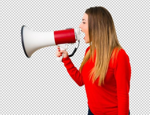 Jonge blonde vrouw die een megafoon houdt Premium Psd