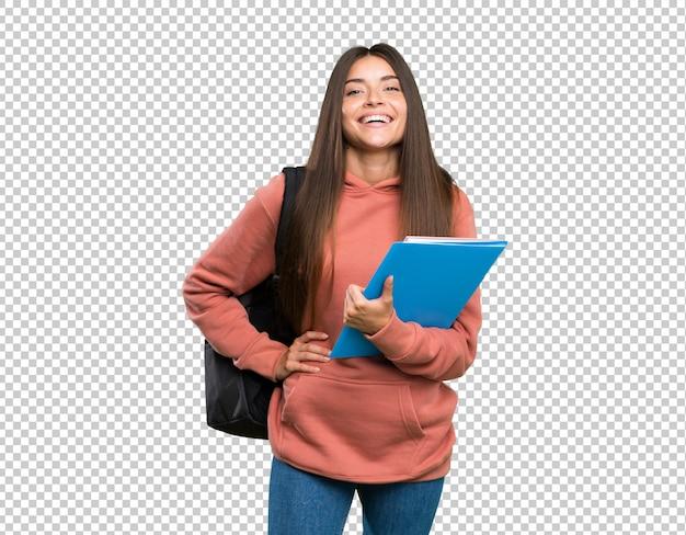 Jonge de holdingsnotitieboekjes die van de studentenvrouw met wapens bij heup en het glimlachen stellen Premium Psd