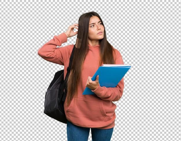 Jonge de holdingsnotitieboekjes die van de studentenvrouw twijfels hebben terwijl het krassen van hoofd Premium Psd