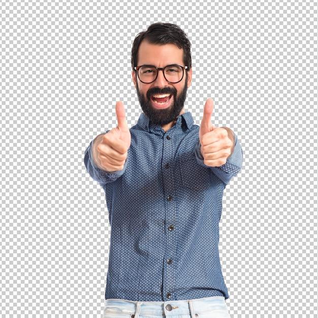 Jonge hipstermens met omhoog duim Premium Psd