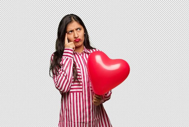 Jonge indiase vrouw vieren valentijnsdag Premium Psd