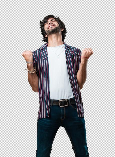 Jonge knappe man erg blij en opgewonden, armen omhoog, een overwinning of een succes vieren, de loterij winnen Premium Psd