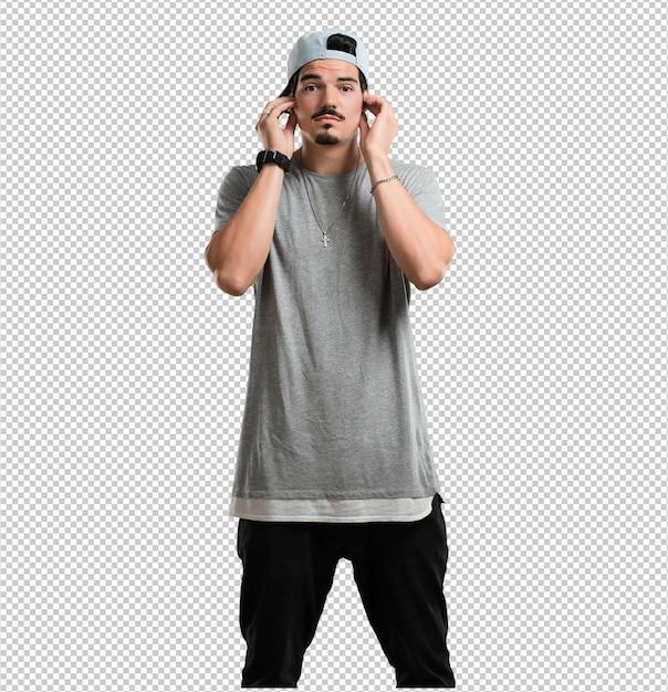 Jonge rapper man die oren met handen, boos en moe van het horen van wat geluid Premium Psd