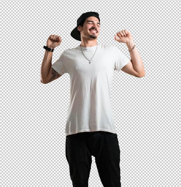 Jonge rapper man luisteren naar muziek, dansen en plezier maken, bewegen, schreeuwen en geluk, vrijheid concept uitdrukken Premium Psd