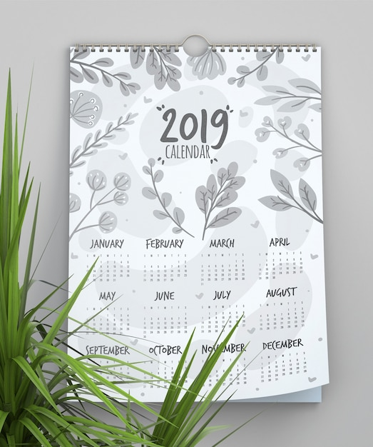 Kalender met bladeren achtergrond sjabloon Gratis Psd