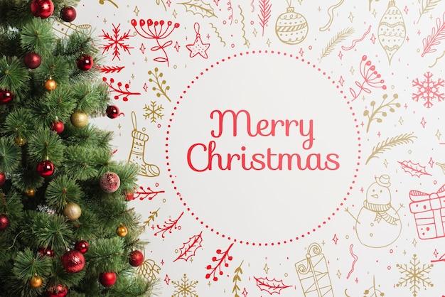 Kerstboom met vrolijk kerstmisbericht Gratis Psd