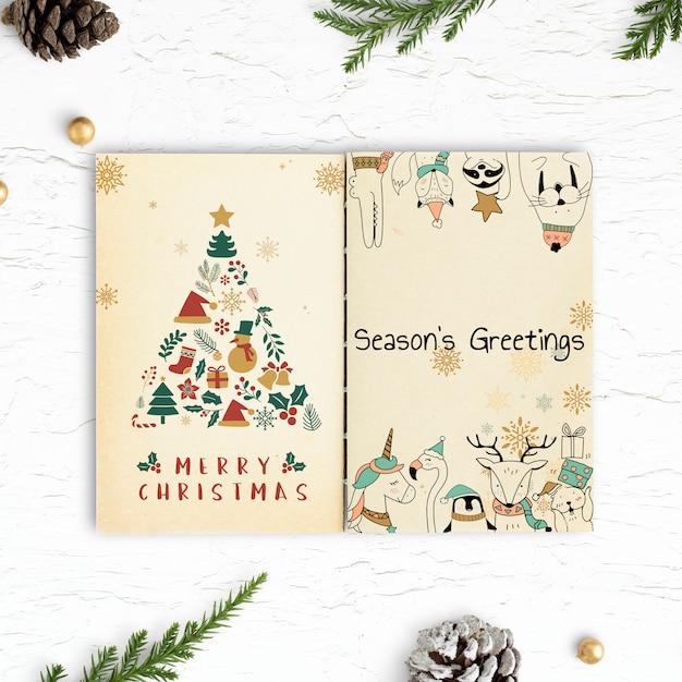Kerstillustraties in een notitieblokmodel Gratis Psd