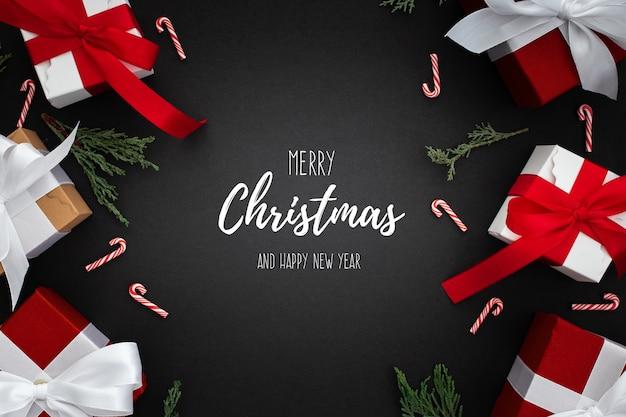 Kerstmisgiften op een zwarte achtergrond Gratis Psd