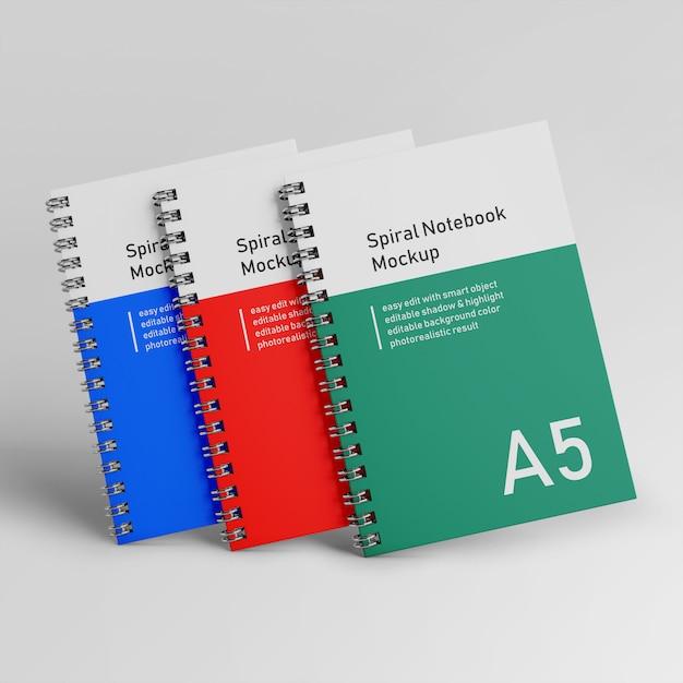 Klaar om te gebruiken drie bedrijf harde kaft spiral binder notitieboek mock up ontwerpsjabloon in front view Premium Psd