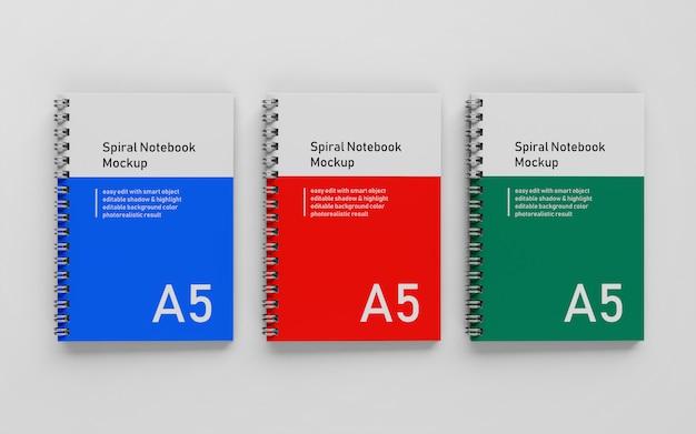 Klaar om te gebruiken triple bussiness hard cover a5 spiraal binder notepad mock up ontwerpsjabloon in bovenaanzicht Premium Psd