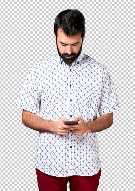 Knappe brunette man met baard praten aan mobiel Premium Psd