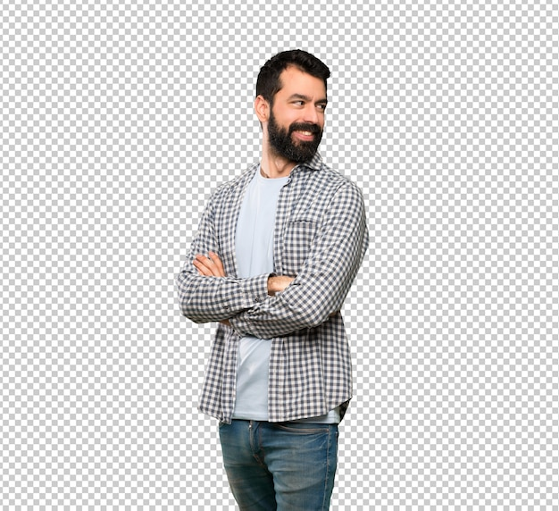 Knappe man met baard met armen gekruist en gelukkig Premium Psd