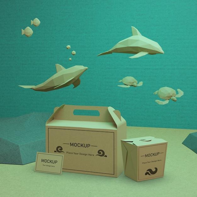 Kraft papieren zakken met dolfijnen en schildpadden Gratis Psd