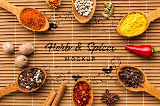 Kruiden en specerijen mock-up omgeven door lepels gevuld met levensmiddelen Gratis Psd