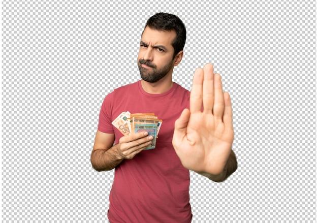 L'uomo prende un sacco di soldi facendo fermare il gesto negando una situazione che pensa in modo sbagliato Psd Premium